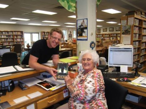 A tirelessly self-promoting author delivers a book to Mrs. Chambers at Dandridge, TN's Memorial Library.