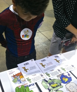 "A spider-man stopped by to get some ""Hub's Adventures"" books!"